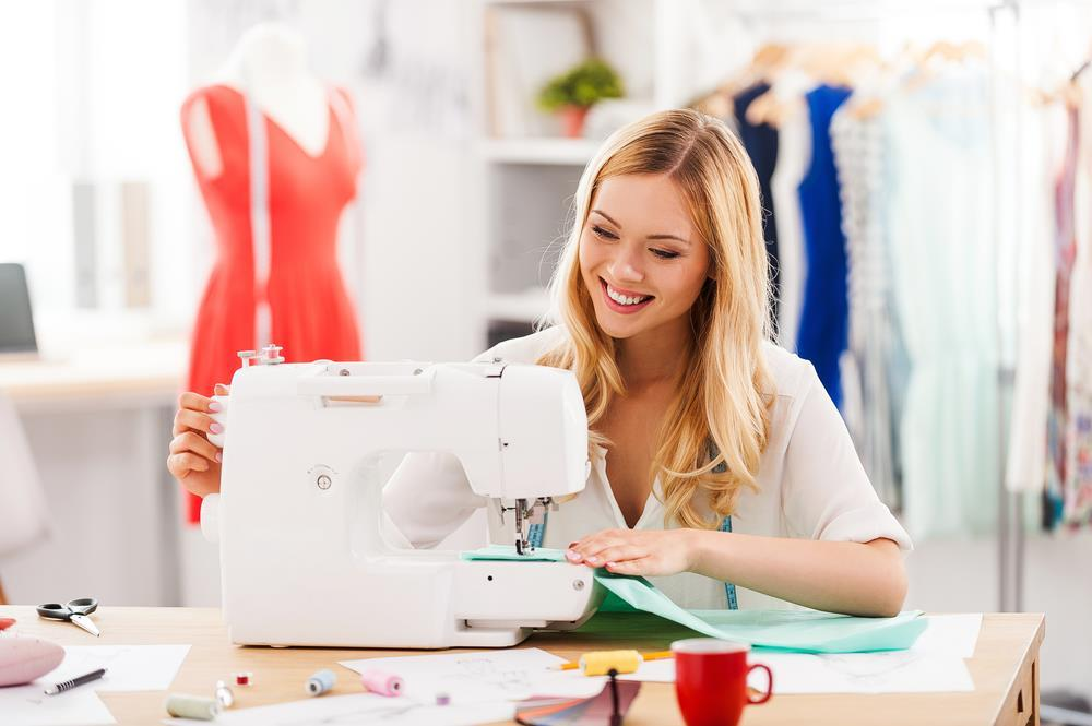 women-sewing-a-suit