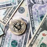 bitcoin-coin-on-bills-of-cash-money