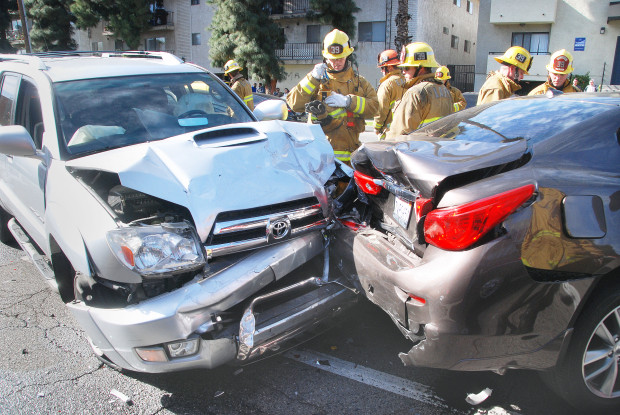 Firefighters extricated a man from the Infiniti sedan, right, on Wednesday, Jan. 24, 2018, after three vehicles crashed on the 7000 block of Van Nuys Boulevard in Van Nuys. Four people were injured, and two of those were hospitalized. (Photo by Mike Meadows/Special to the Los Angeles Daily News)