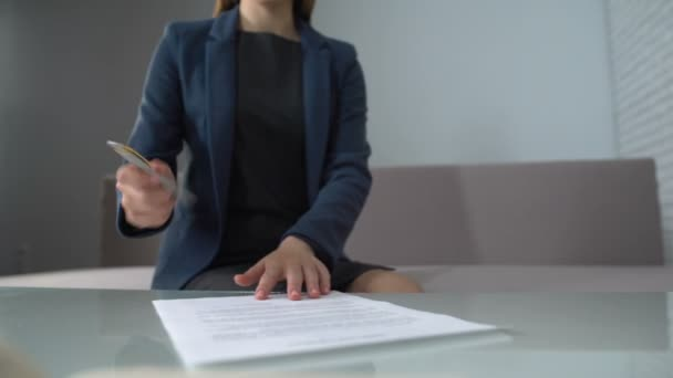 depositphotos_197993478-stock-video-woman-signing-documents-to-receive